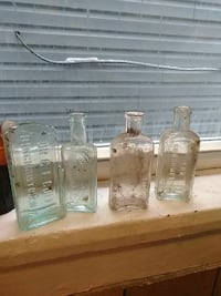 four clear glass bottles