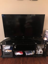 """42"""" LG TV with tempered glass stand. Only $300 obo"""