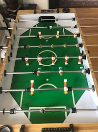 White and green wooden foosball table, great for all ages, selling because lack of storage space, PRICE IS NEGOTIABLE Toronto, M9W