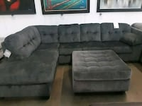 gray suede sectional couch with ottoman 1157 mi