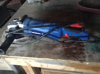 Blue and black corded angle grinder