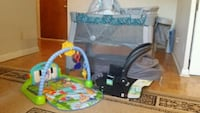baby's black and green travel cot Toronto