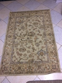 Brown and beige floral area rug 537 km
