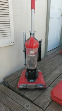 Red and black dirt devil upright vacuum cleaner
