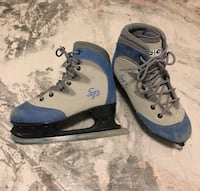 Pair of gray-and-blue ice hockey skates Winnipeg, R3Y