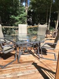 glass top table with five chairs patio set Saint-Lazare, J7T 3H8