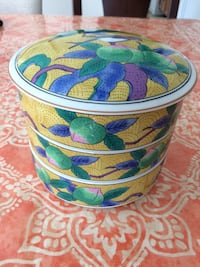 white, blue, and green floral ceramic canister