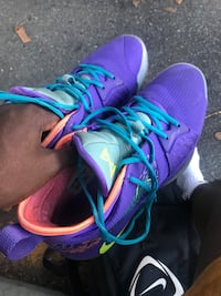 Pair of purple-and-teal running shoes New York, 10468