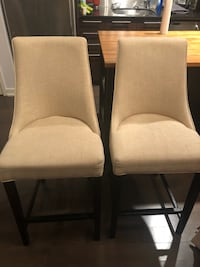 two white padded brown wooden chairs Vaughan
