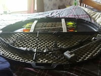 Host compound bow with case and arrows  209 mi
