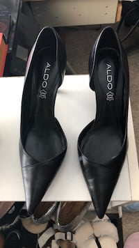 pair of black leather pointed-toe heels Vancouver, V5P 3R3