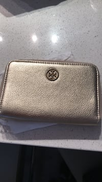 Brand new cellphone plus wallet case. Tory Burch. Edmonton, T5T 4N3