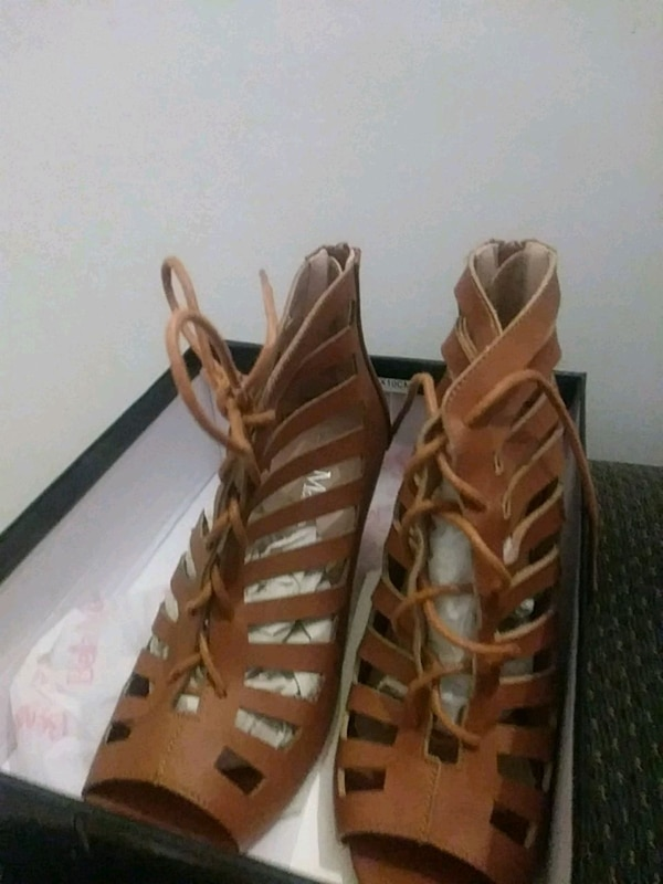 pair of brown leather open-toe sandals