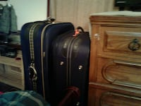 two blue and black luggages