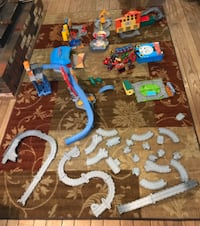 Thomas the Train playsets and trains. Includes blue carrying case for the trains. Includes 21 trains. Includes extra track. Toms River