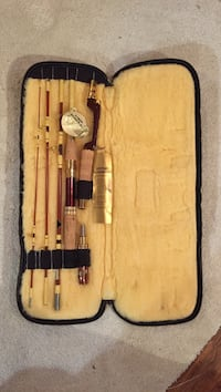 Brown and white fishing rod with black and yellow case