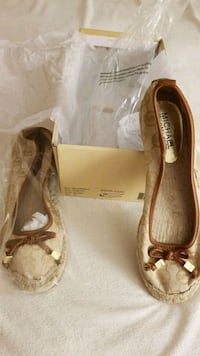 pair of brown leather canvas flats