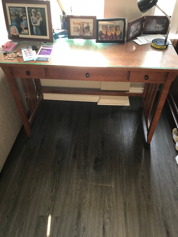 Brown wooden single-pedestal desk