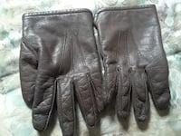 pair of gray leather hand gloves