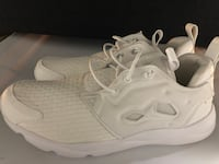 pair of white Nike running shoes Portland, 97201