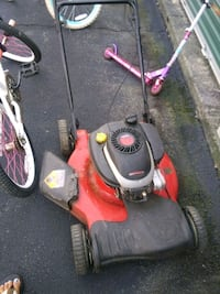 red and black push mower Griswold, 06351