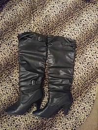 women's pair of black leather boots