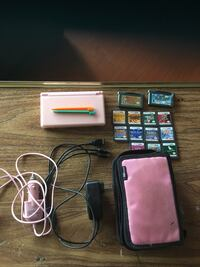 Pink Nintendo DS with games and accessories