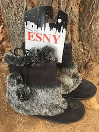 pair of black-and-gray fur boots