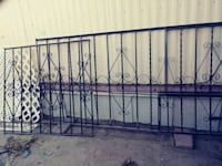 black wrought iron gates, one long the other less  Indio, 92201