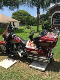 Red and black touring motorcycle low mileage