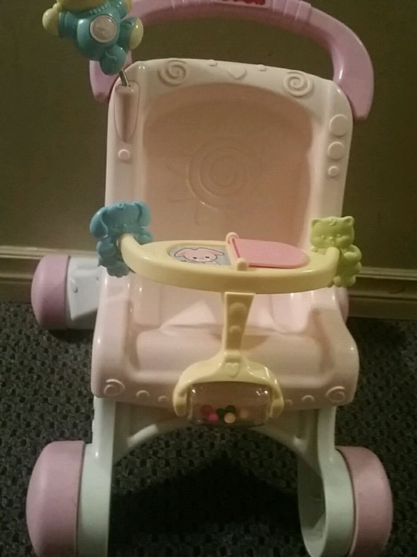 pink, yellow, and white plastic activity walker