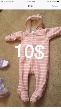 baby's pink and white striped jumpsuit 717 km