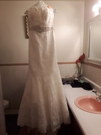 women's white lace wedding gown