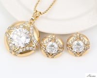 Brand New Harma 18K gold plated Pendant/Locket set in real cubic Zirconia stones