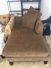 brown fabric sofa chair with throw pillow Annandale