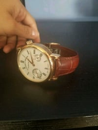 round gold-colored chronograph watch with brown leather strap Los Angeles, 90038