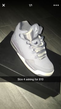 unpaired white Air Jordan 5 shoe with box Chicago, 60629
