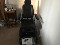 black leather padded powered wheelchair with blue frame