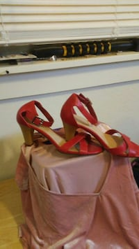 pair of red open-toe ankle-strap cone-heeled sandals