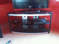 BLACK STAINED GLASS TV STAND IN MINT CONDITION