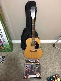 Brown and black acoustic guitar, case, unopened DVD lessons Winnipeg, R2N 2W1