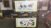 two brown wooden framed painting of flowers