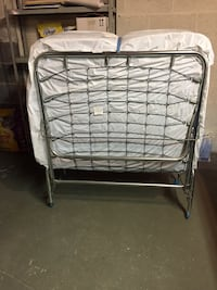Folding bed with mattress. Original price was $135.