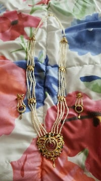 white and gold-colored necklace Arlington, 12603