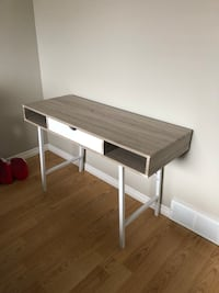 brown and white wooden desk London, N5W 6E2