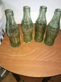 Vintage green coca cola bottles. All for $15