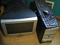 black and gray computer monitor with keyboard, mouse, and tower