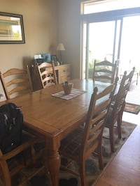 rectangular brown wooden table with six chairs dining set Castle Rock, 80109