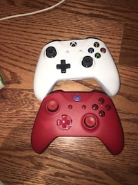 White xbox one game console two brand new controllers and controller case Toronto, M9N
