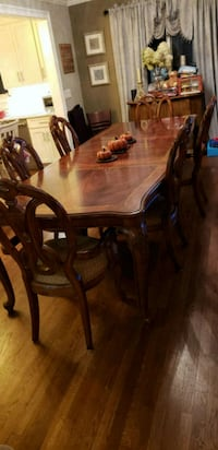 rectangular brown wooden table with six chairs din Westhampton Beach, 11978
